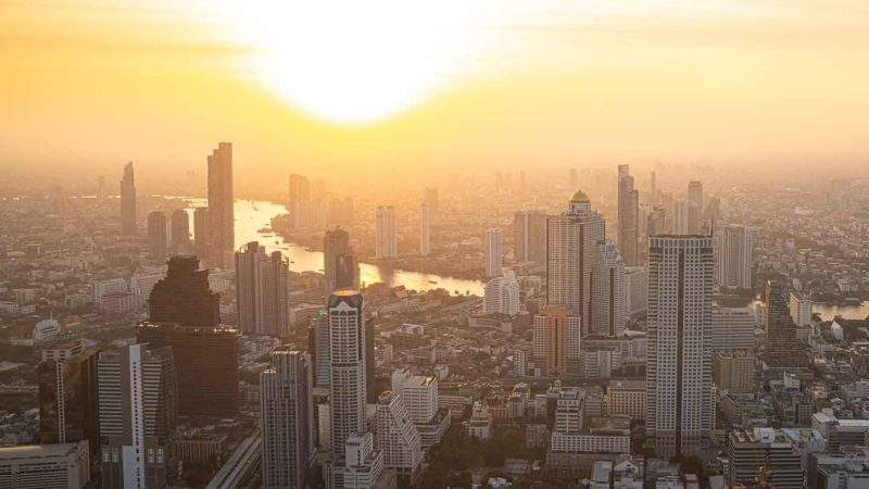 Golden sunset over the city of Bangkok viewed from a rooftop Sky Bar