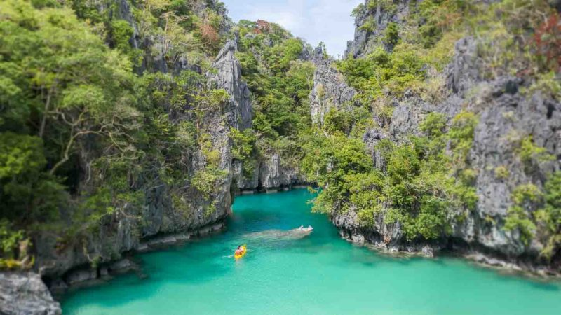 Yellow Kayak entering the small lagoon in El Nido - Top things to do in the Palawan Islands