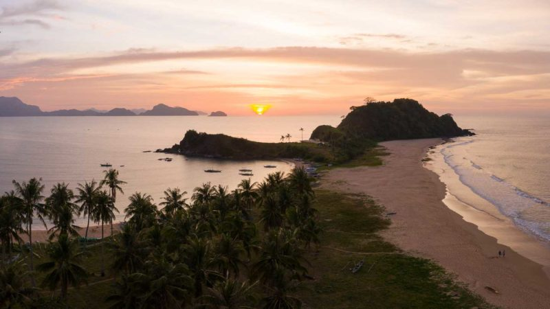 Orange Sunset over Nacpan Beach near El Nido - Things to do in the Palawan Philippines