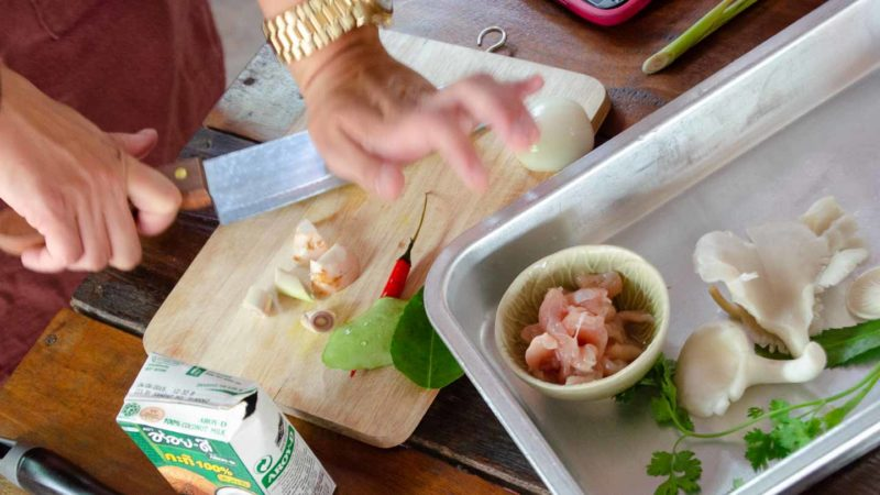 Woman cutting food duing a Thai Cooking class - Top activities in Koh Phangan Thailand