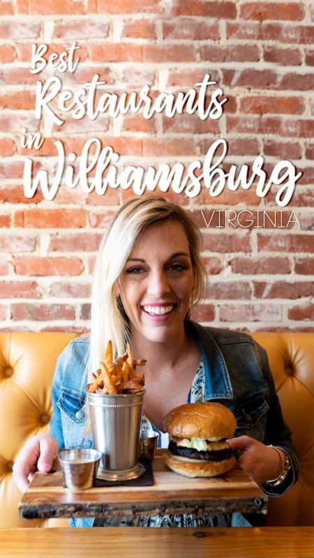 woman holding a burger - Pin for Best restaurants in Williamsburg Virginia