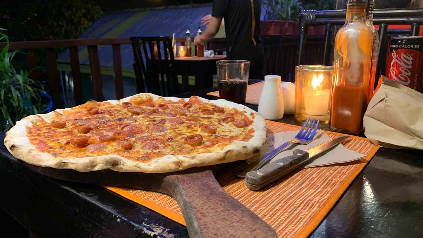 Pizza on a wooden board at Altrove Pizza in the Philippines
