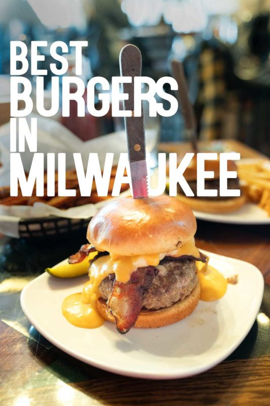 "Large burger with a knife stuck in the top with text ""Best Burgers in Milwaukee"" - Pinterest Pin"