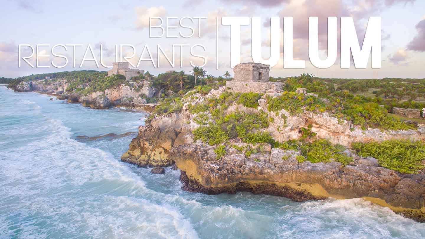 "Aerial view of the Tulum Ruins with white text ""Best Restaurants in Tulum"" - Featured Iamge"