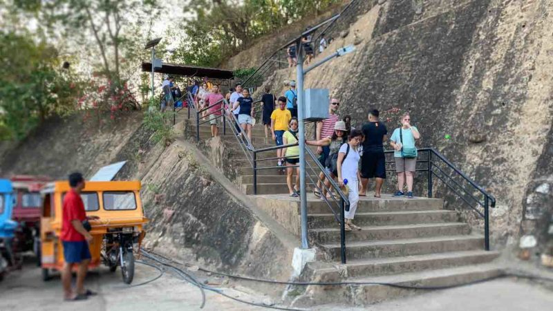 Group of people at the start of the stairs that lead to the best views - Mt. Tapyas Coron