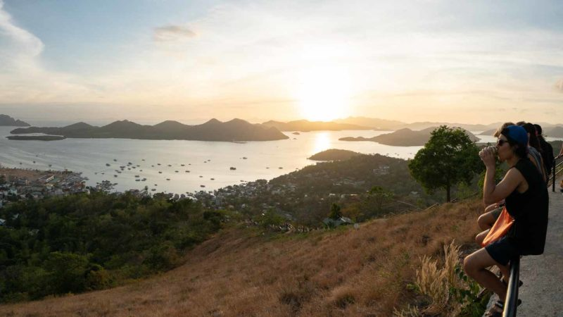 People watching sunset at the top of Mt Tapyas - Top things to do in Coron
