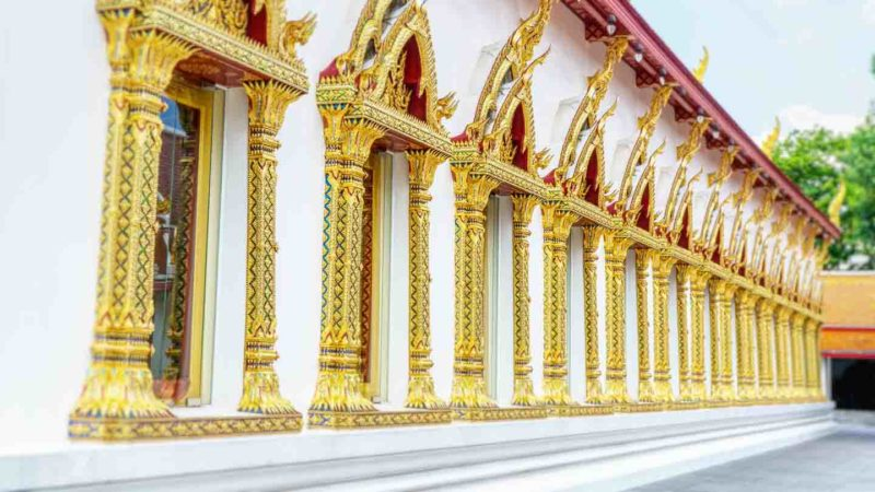 A row of gold trimmed doorways on the Chana Songkhram Temple in Bangkok Thailand