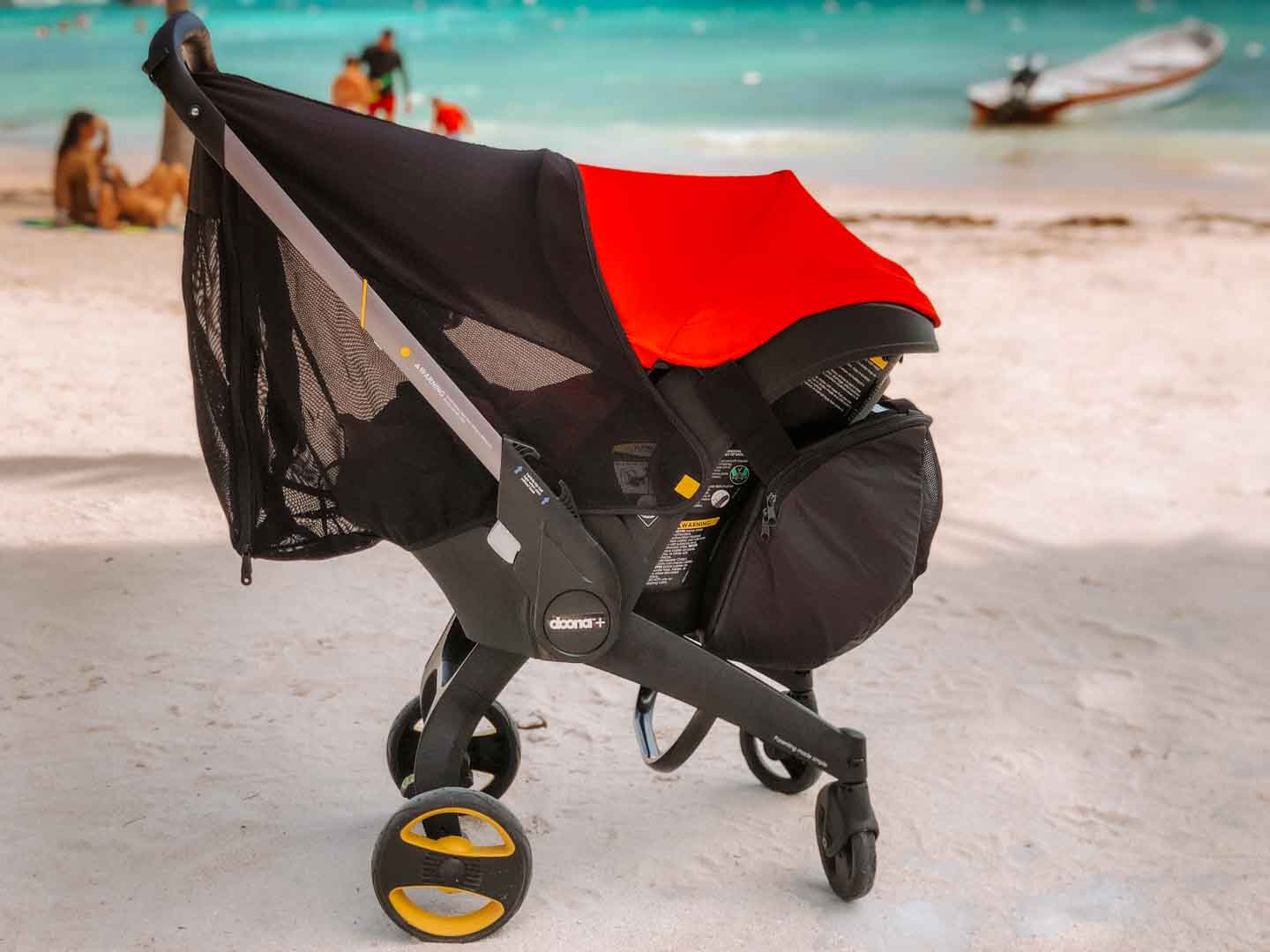Doona Stroller on the beach