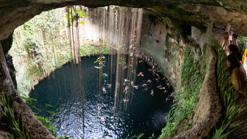 View from the viewing platform of Cenote Il Kil - perfectly circular and lush cenote in Mexico